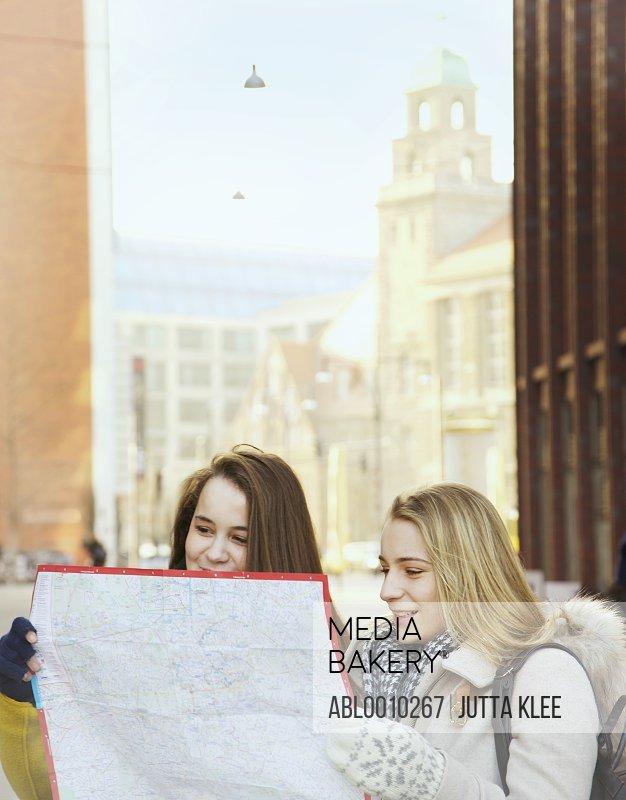 Teenage Girls Checking Map