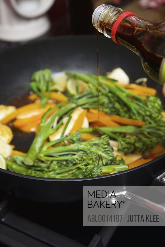 Adding Soy Sauce to Vegetable Stir Fry