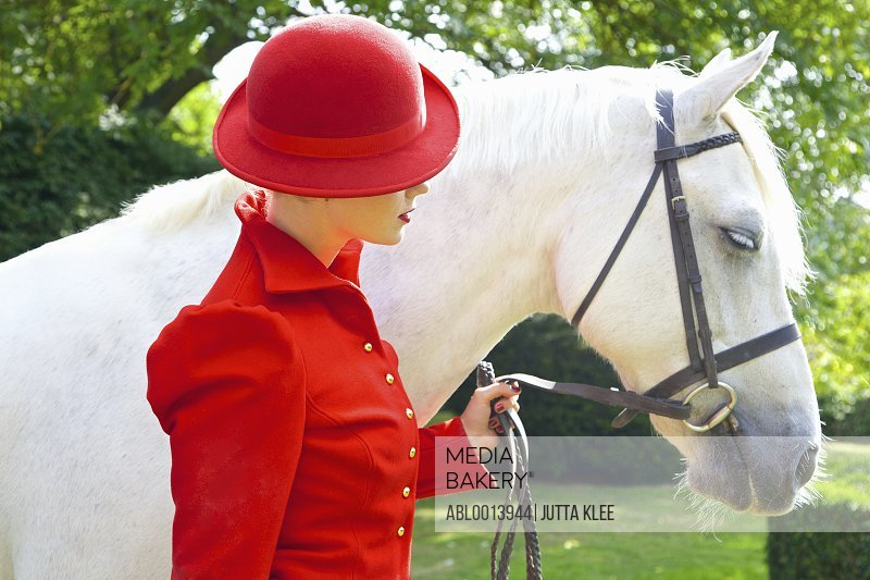 Woman in Red Equestrian Outfit with Horse