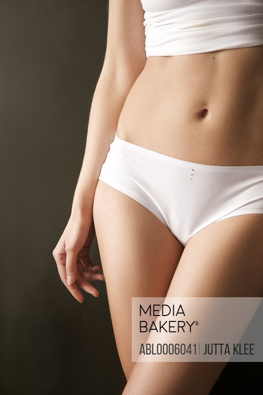 Close up of a woman's body wearing white underwear