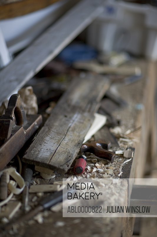 Messy boat builder workshop with plane and wood shavings