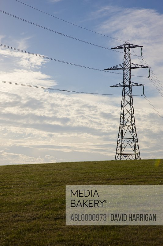 Electricity pylon on a field