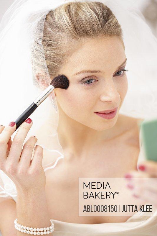 Bride Applying Blusher on Face