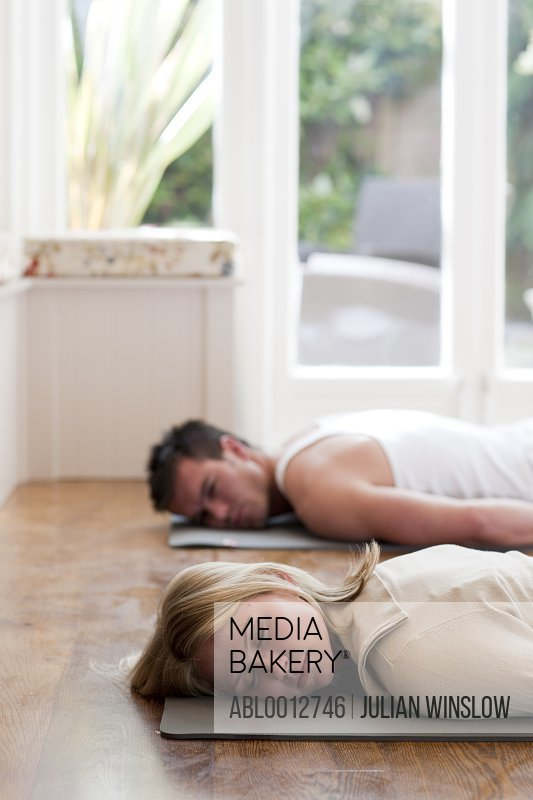 Man and woman relaxing during a yoga practice
