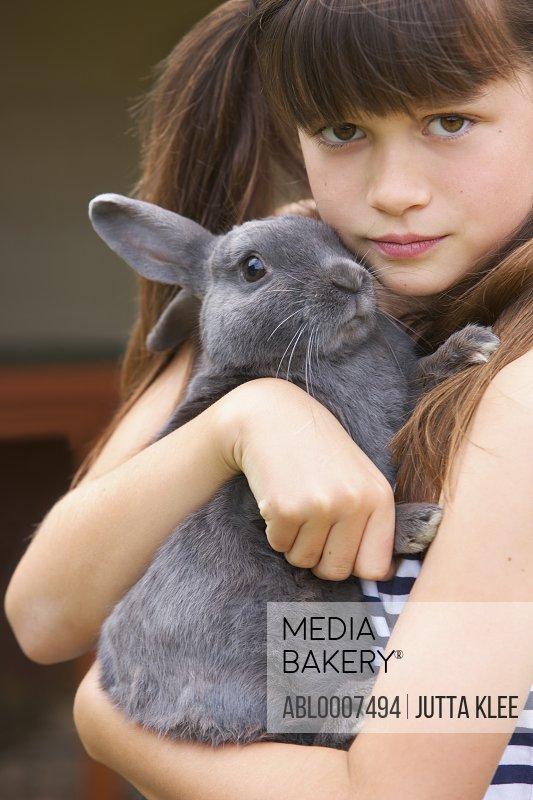 Girl Hugging Grey Rabbit