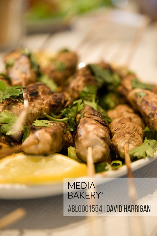 Close up of chicken satay skewers