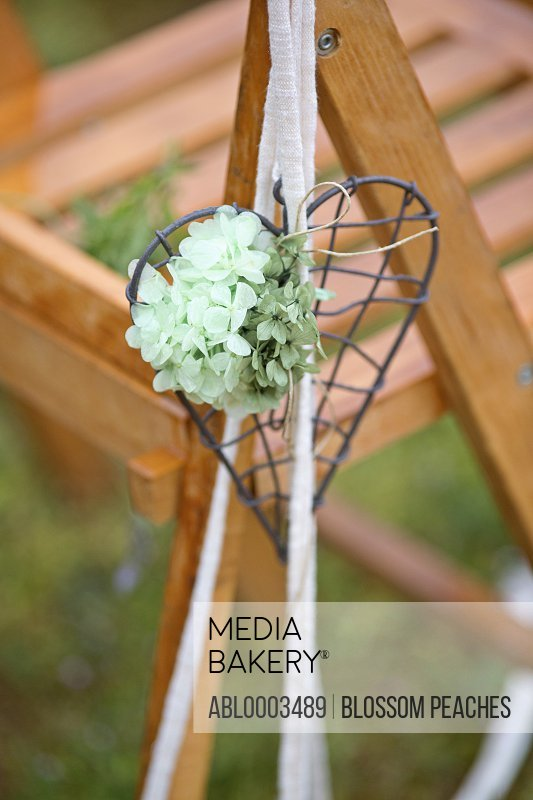 Heart Shaped Decoration with Flowers Hanging from Chair, Close-up View