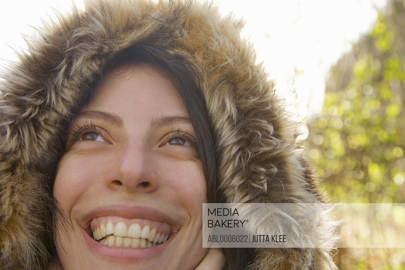 Close up of a smiling woman wearing a hooded parka