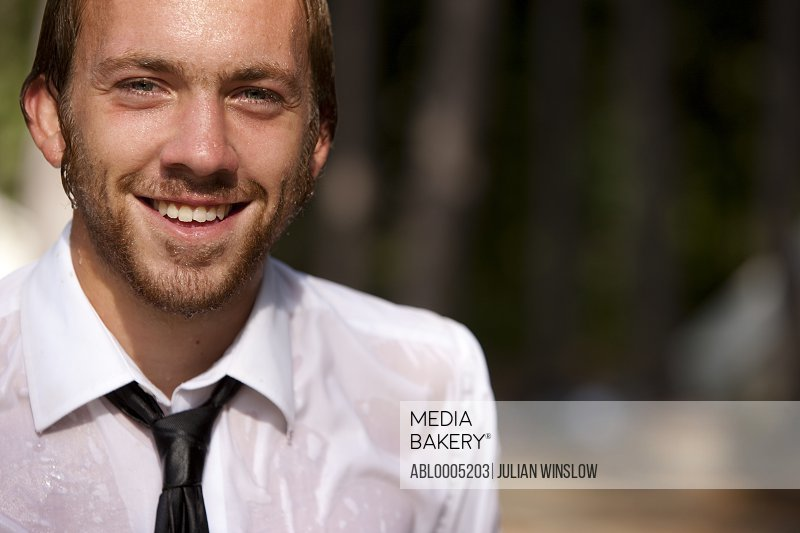 Smiling and soaked businessman