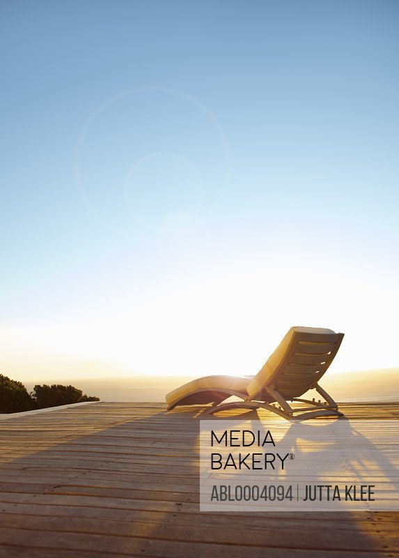 Sun Lounger on Deck at Sunset