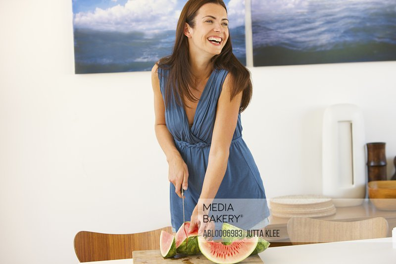 Smiling Woman Slicing Watermelon