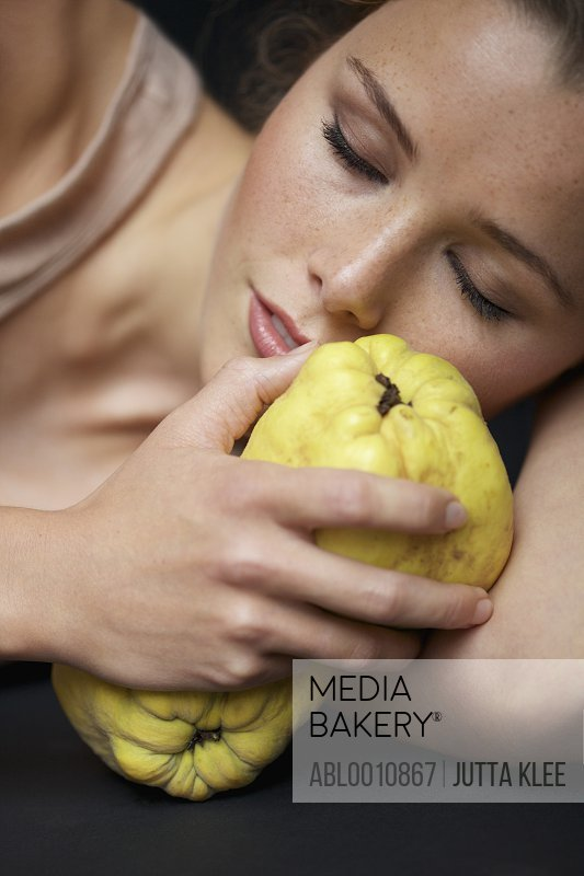 Close up of Young Woman Holding Quinces