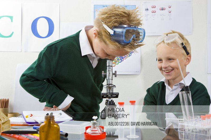 Two boys in a chemistry classroom