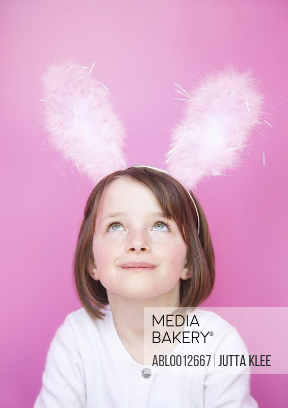 Smiling girl wearing bunny ears