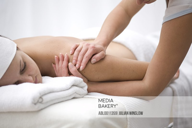Woman receiving a back and shoulder massage