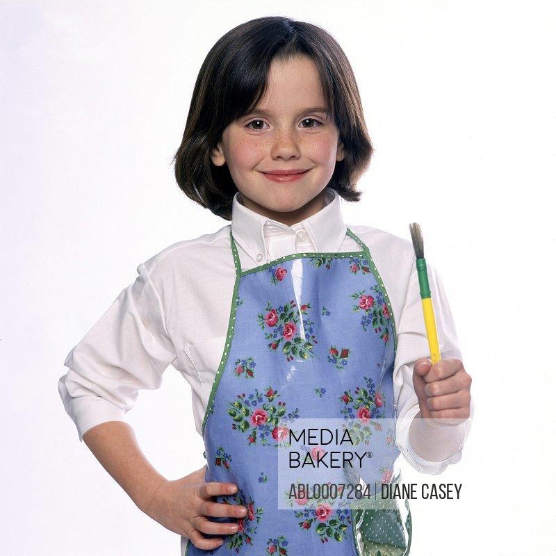 Girl Wearing Apron Holding Paintbrush