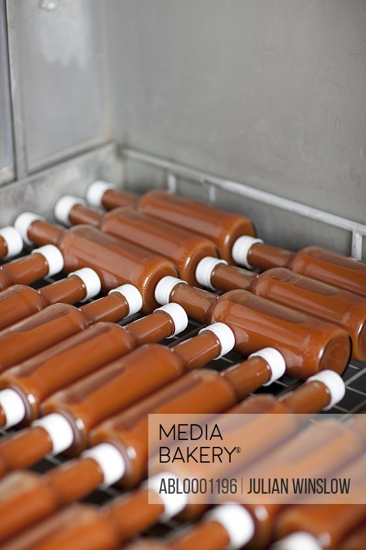 Tomato sauce bottles lying on a rack