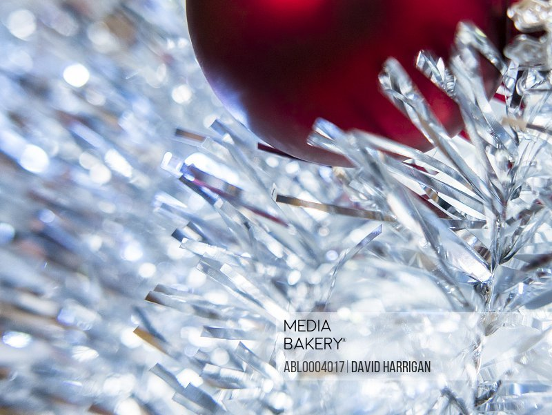 Red Christmas Bauble and Silver Tinsel, Close-up view