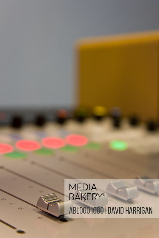 Close up of a mixing board in a recording studio