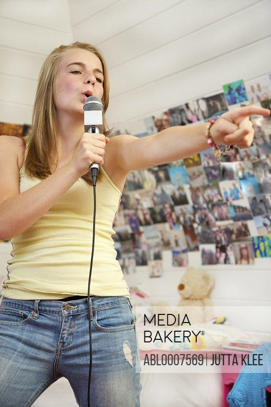 Teenage Girl Singing into Microphone