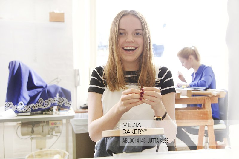 Smiling Female Employee at Embroidery Design Studio