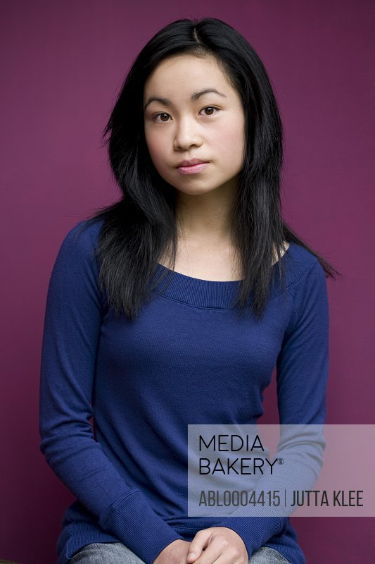 Portrait of young beautiful teen sitting