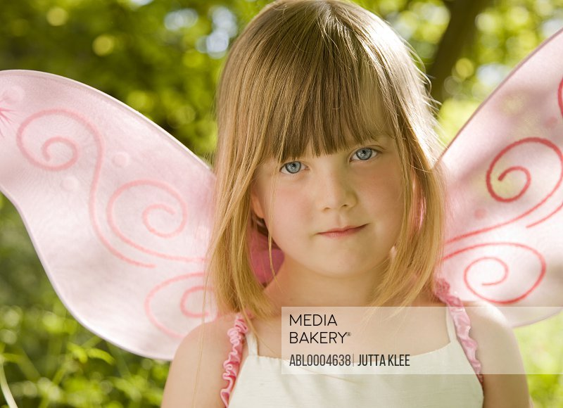 Close up of  girl in a pink fairy costume