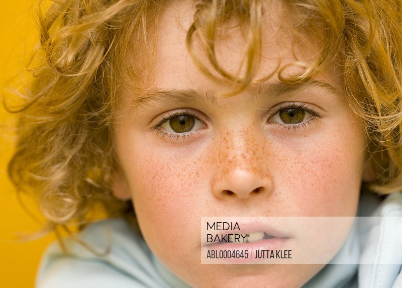 Close up of boy with curly hair