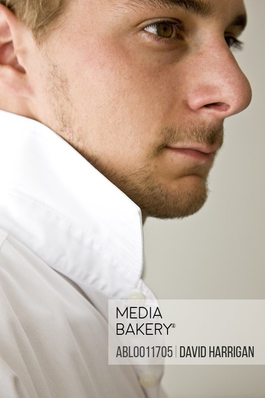 Profile of young man with shirt collar up