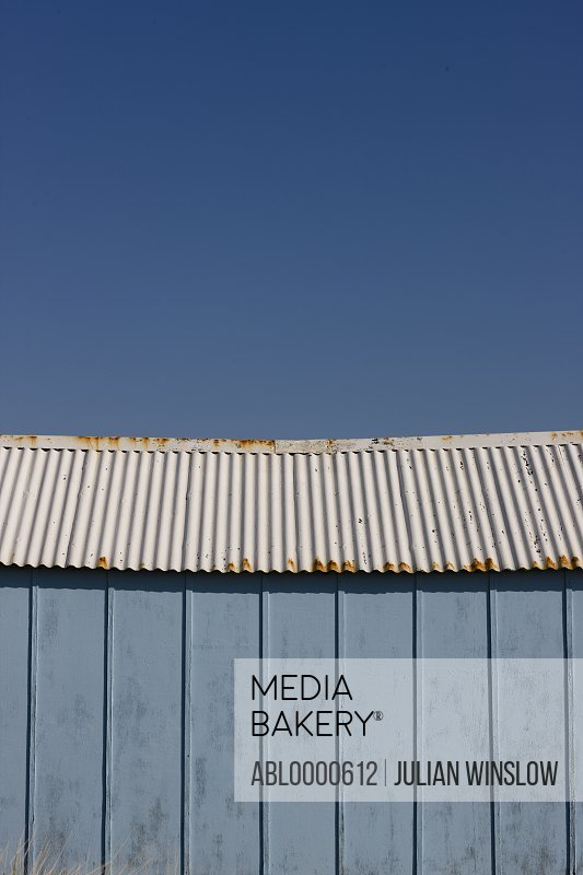 Close up of light blue beach hut and blue sky