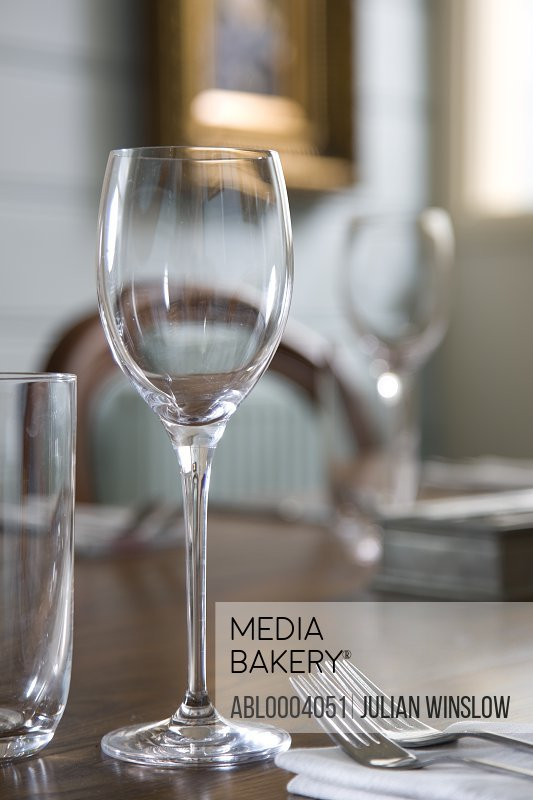 Close up of glasses on  a table in a empty restaurant dining room