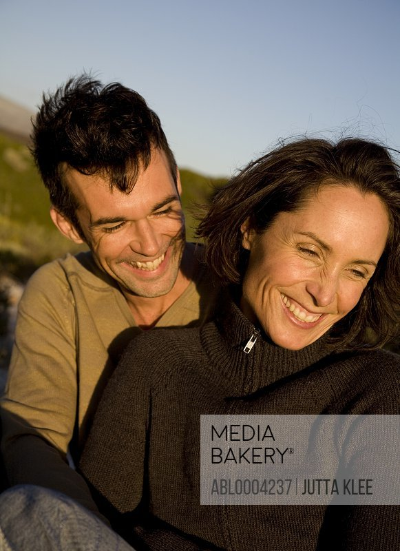 Portrait of couple embracing and laughing
