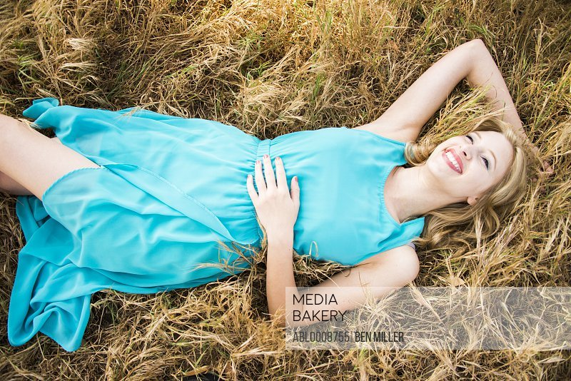 Smiling Woman Lying in Grass