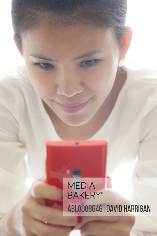 Woman Using Red Smartphone