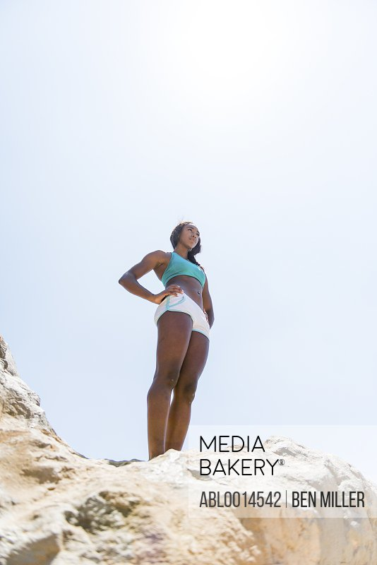 Sportswoman Standing on Rock, Low angle view