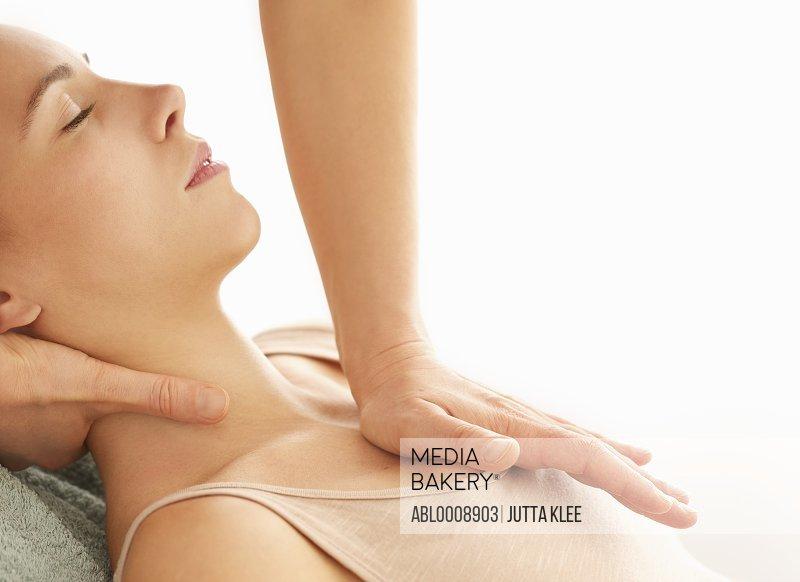 Profile of Woman Receiving a Thai Yoga Massage