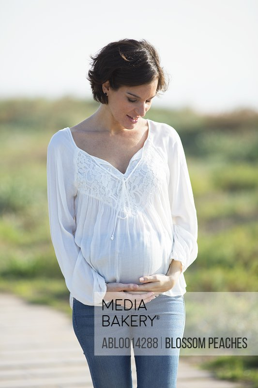 Smiling Pregnant Woman Outdoors