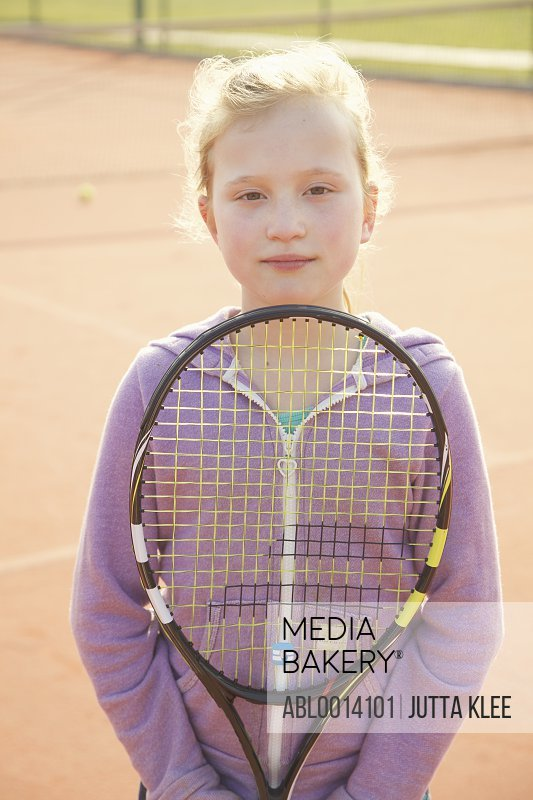 Young Girl Holding Tennis Racket