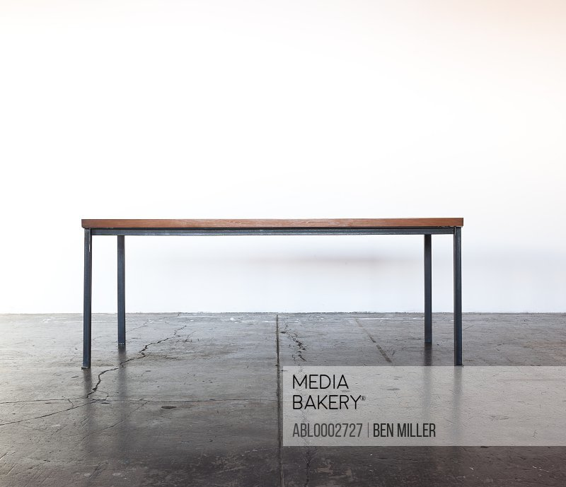 Iron Frame Wooden Table on Concrete Floor