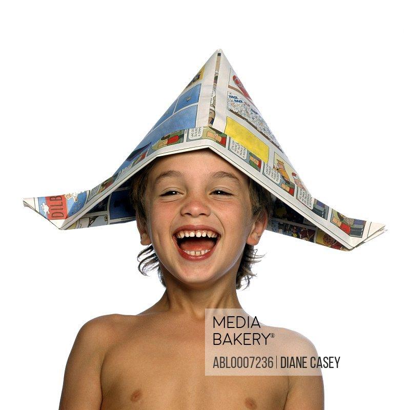 Boy Wearing Newspaper Hat Laughing