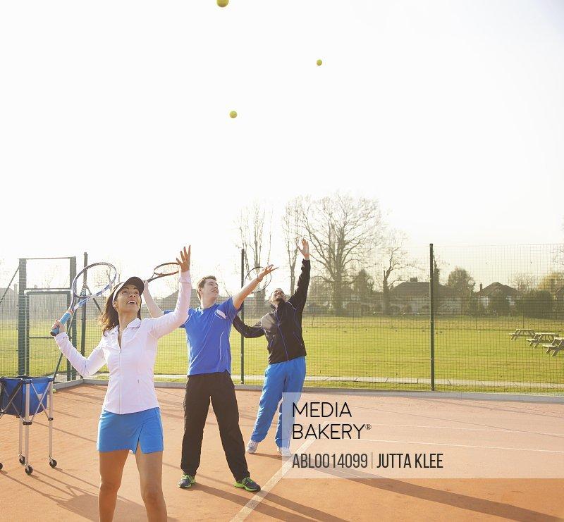 People Practicing Tennis