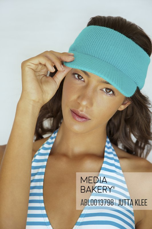 Young Woman Wearing Blue Visor Hat