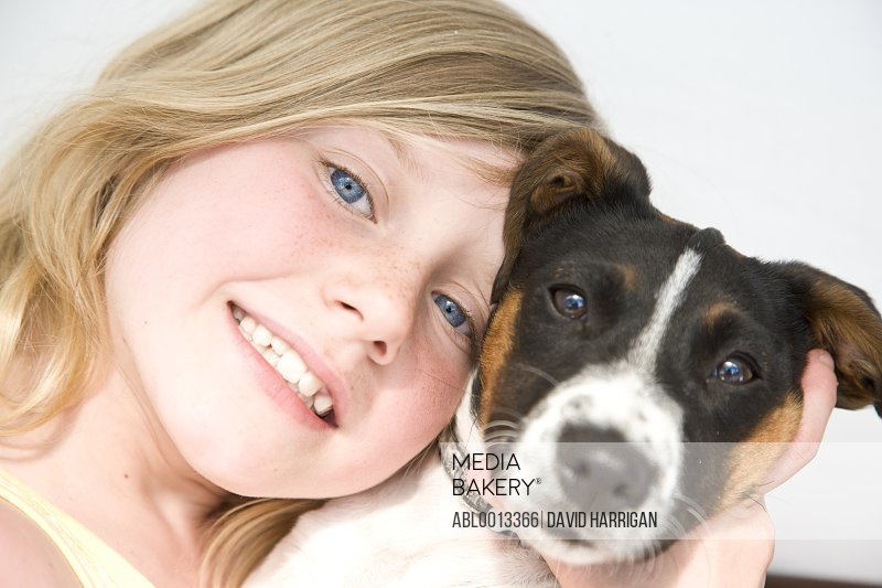 Girl Hugging Jack Russell Puppy