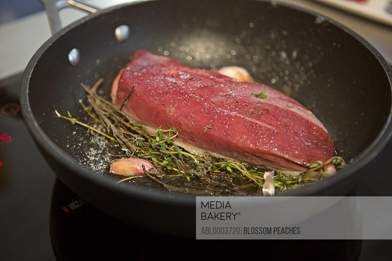 Duck Breast and Herbs in Frying Pan