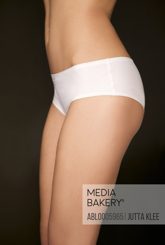 Profile of a woman's body wearing white underwear