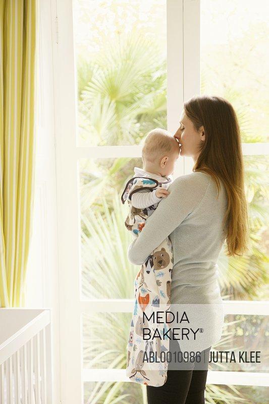 Mother Cradling Baby in Nursery