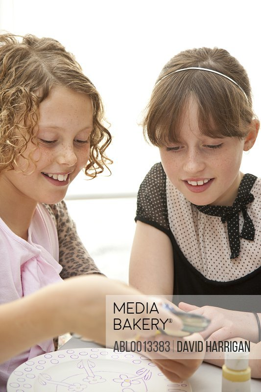 Two Girls Looking at Colour Sample