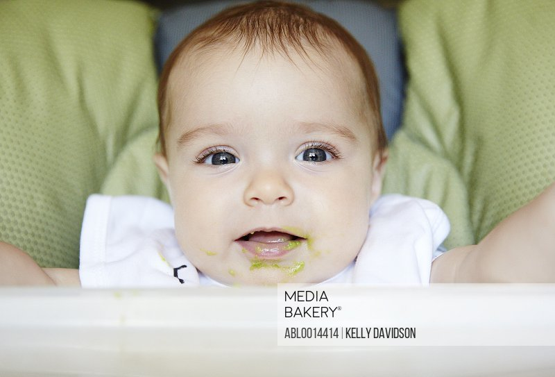Baby Girl with Food on Mouth