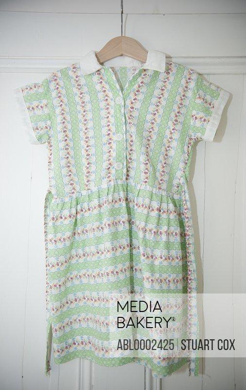 Girl's Dress Hanging on Wardrobe Door