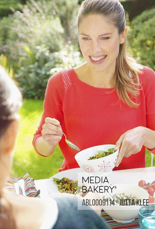 Woman Having Lunch in Garden with Friend
